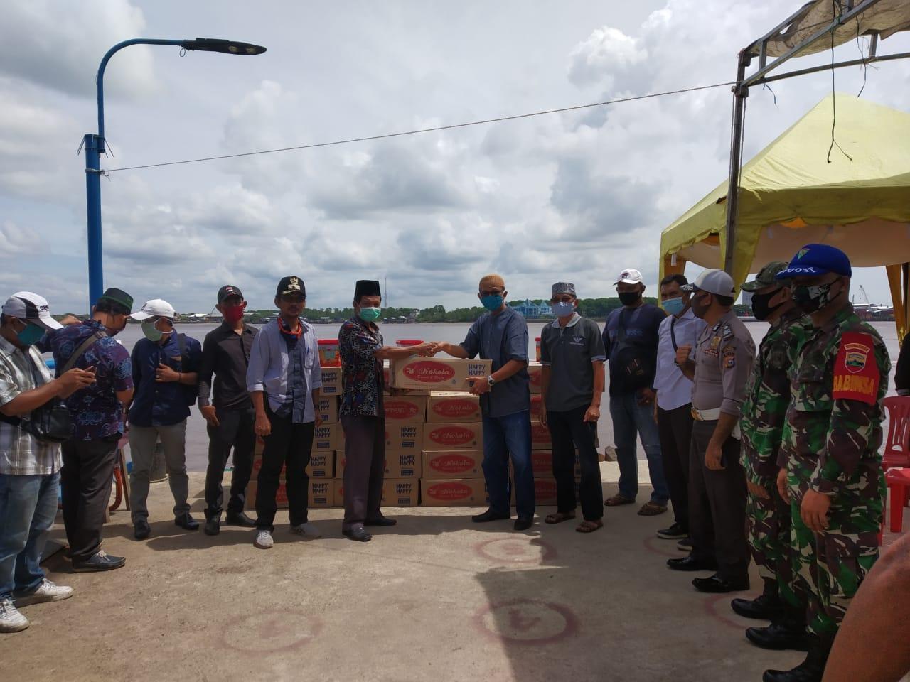 Melalui Yayasan Dwipa Abadi,PT Pulau Sambu Group Membagikan 14.000 Roti Kaleng